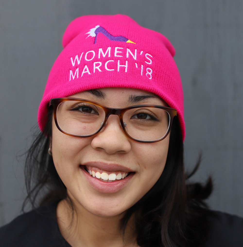 girl with womens march cap.jpg