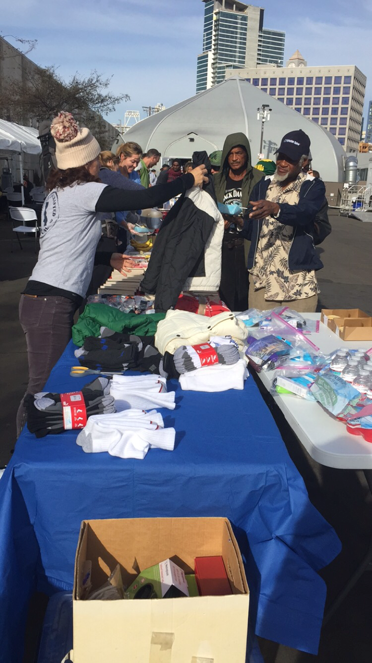 Newport Cottages giving out socks, jackets, and care packs their loyal costumers provided during the Holiday season!