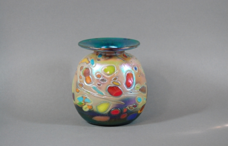 Green vase with multi colored frit.