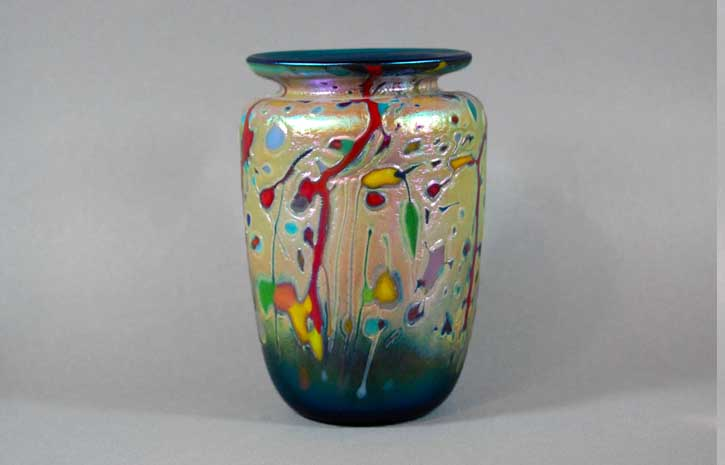 Green vase with multi colored cane