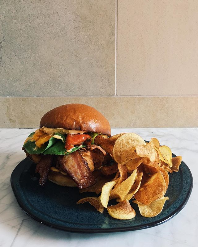 Brunch special 🙌🏽 Buttermilk Fried Chicken Sandwich • smoked bacon • Green House greens • Fresno Aioli Kettle chips 🌱 on the menu today! Brunch til 3 PM Saturday and Sunday