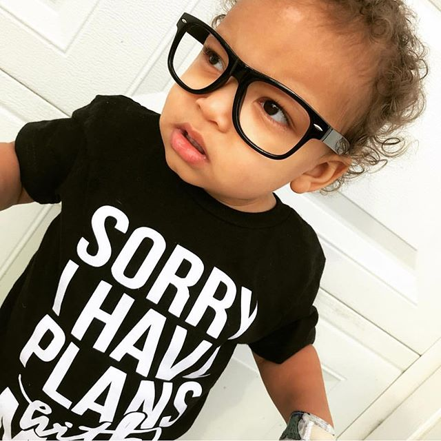 """Saw this little cutie pop up on my screen sporting our """"Sorry I Have Plans with Mom"""" tee and I had to share. Click link in bio to shop this tee. 😎 #momsidekick #bestseller"""