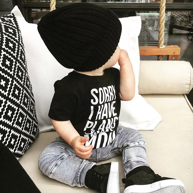 """This little cutie wearing our bestseller, """"Sorry I have plans with Mom"""" tee. Link to shop in bio."""