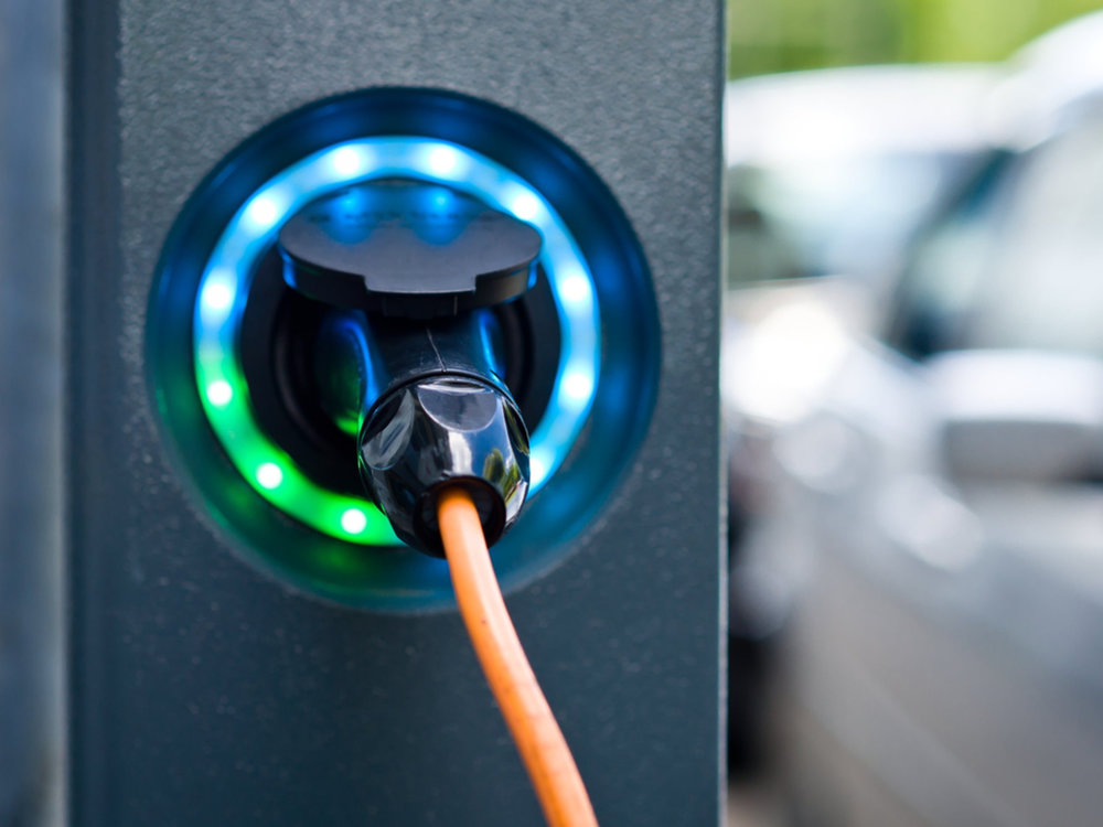 stock-photo-socket-for-electrical-car-battery-charger-with-load-indicator-lights-selective-focus-286615691.jpg