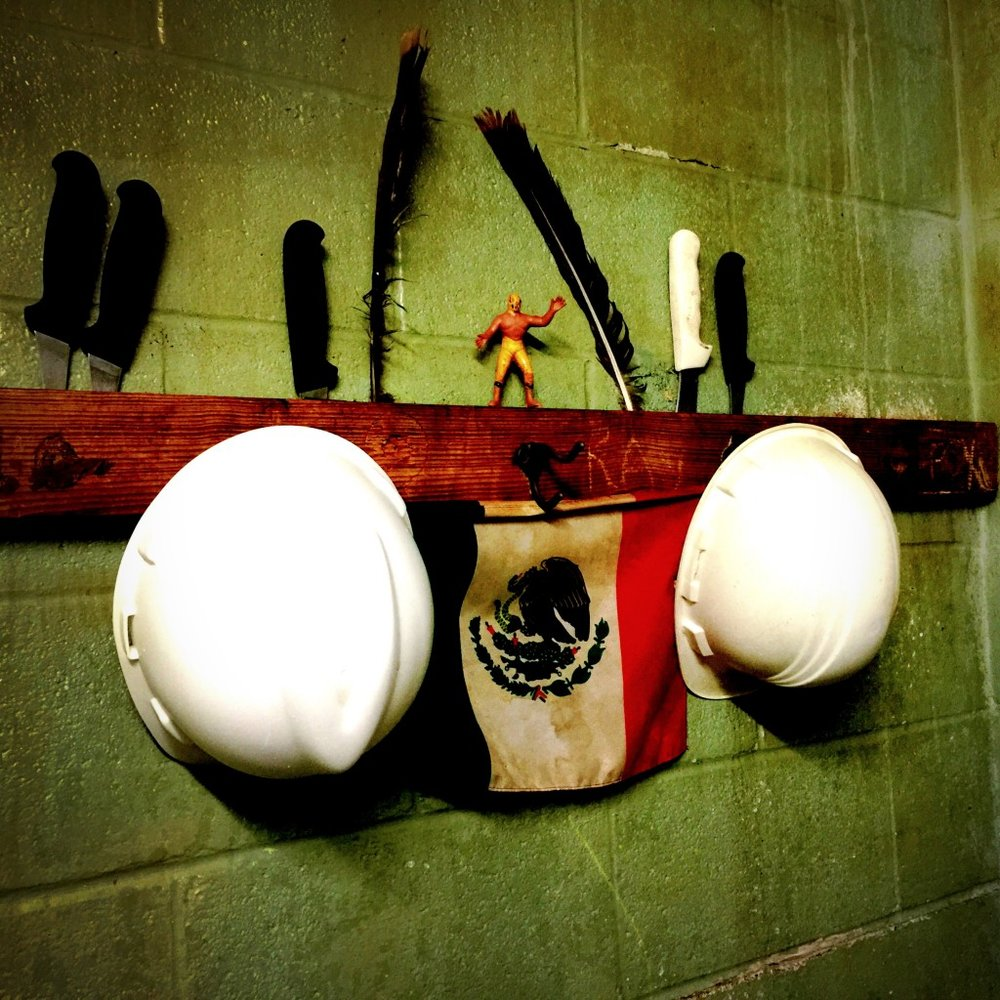 Corporate Break Room: hardhats, knives, Mexican flag, and Lucha Libre