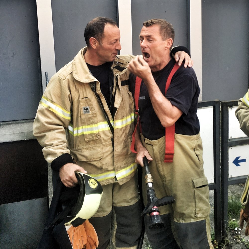 It was this firefighter's last fight - he was retiring the following day, so he ask for pictures with one of the worms - before jokingly gesturing he was going to swallow the burnt one.