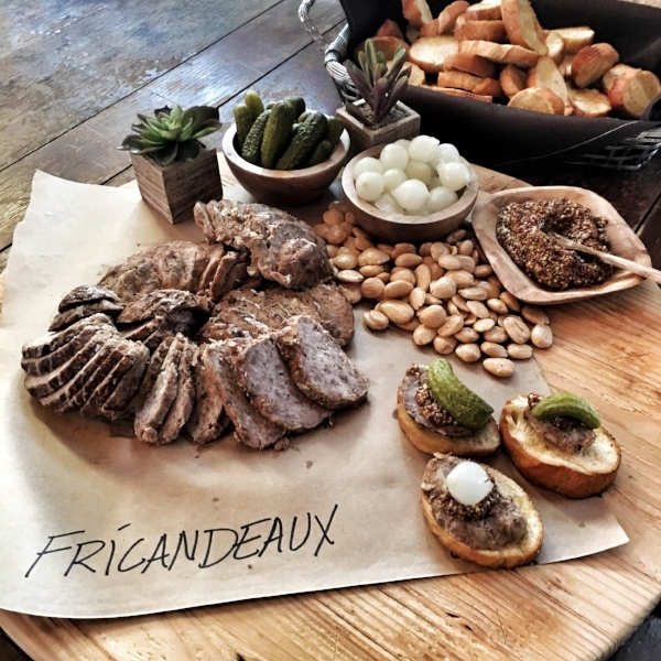 Frícandeaux, sliced and served with cornichons, onions, and whole grain mustard.