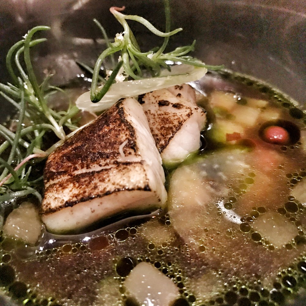 A combination of fresh fish and preserved vegetables in broth.
