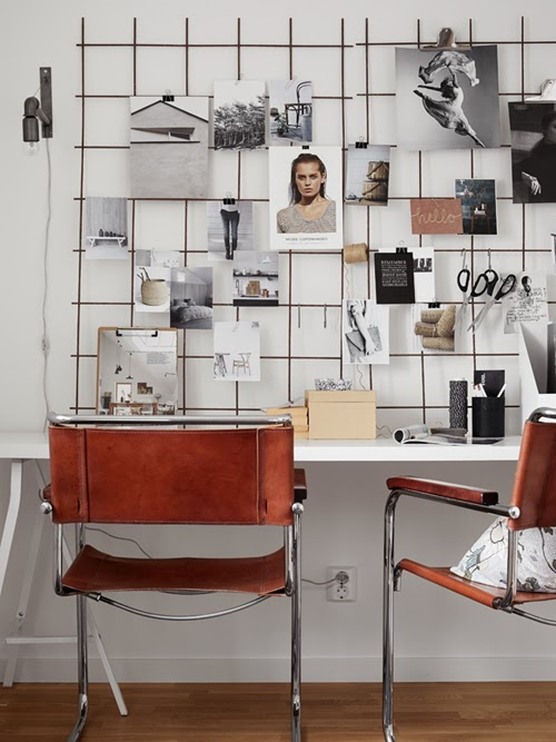 workspace-with-inspiring-moodboard-and-metal+leather-chairs