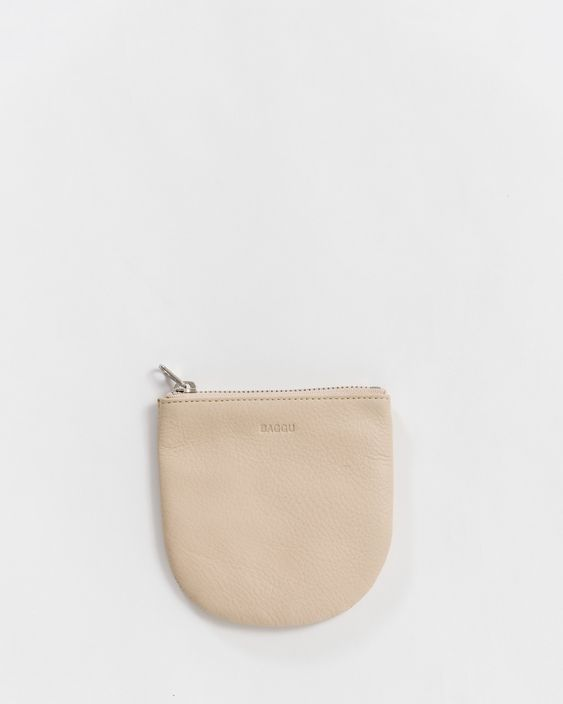 I got one of these little  Baggu change wallets  years ago and I still love it! It gets better with wear.