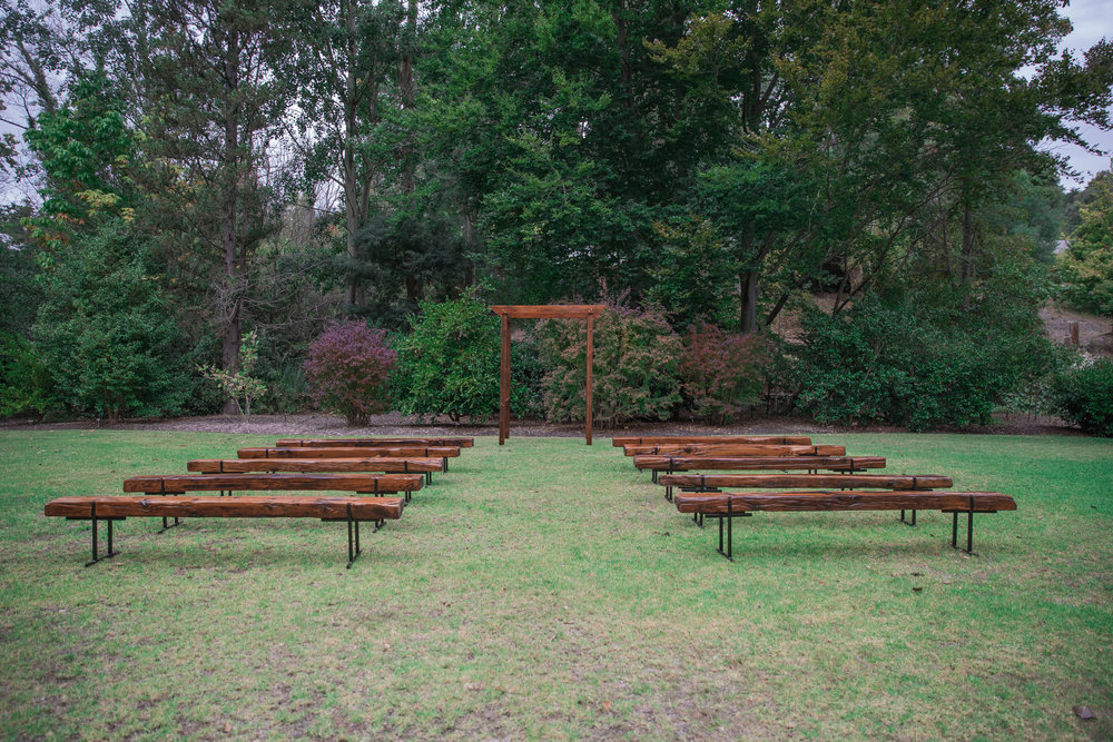 The Rustic Barn restored railway sleeper ceremony benches and four-post arbour