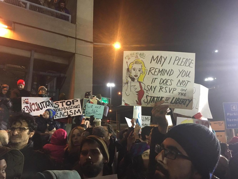 Protest sign quotes Clueless character Cher Horowitz, John F. Kennedy International Airport Terminal 4.