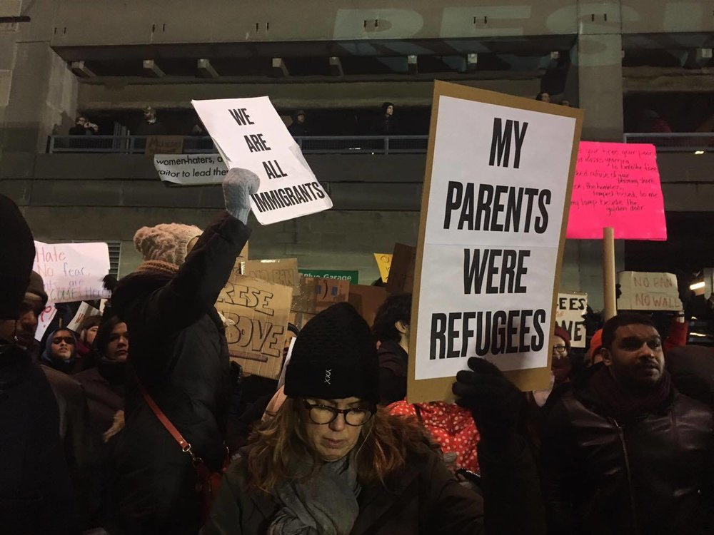 Protesters display their signs, John F. Kennedy International Airport Terminal 4.