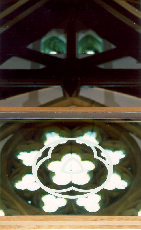 Glass balustrade with rose window motif
