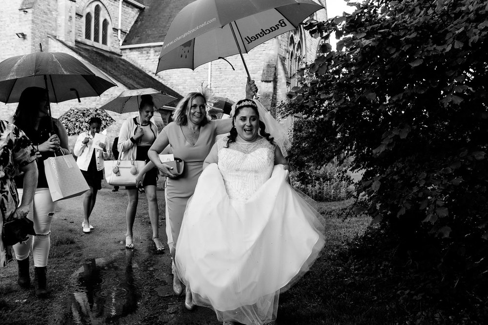 Josh Tomalin Wedding Photographer escaping the rain