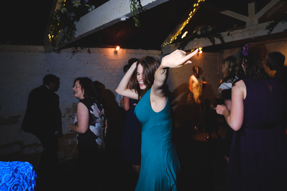 Josh Tomalin Wedding Photographer getting down