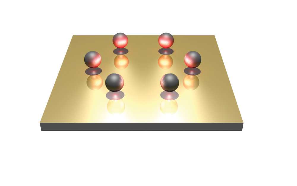 Like a decorator placing cherries atop a fresh-baked cake, scientists used light-based nanotweezers to precisely position six silver balls, each a thousandth the width of a human hair, in a ring.  Credit: Linhan Lin.