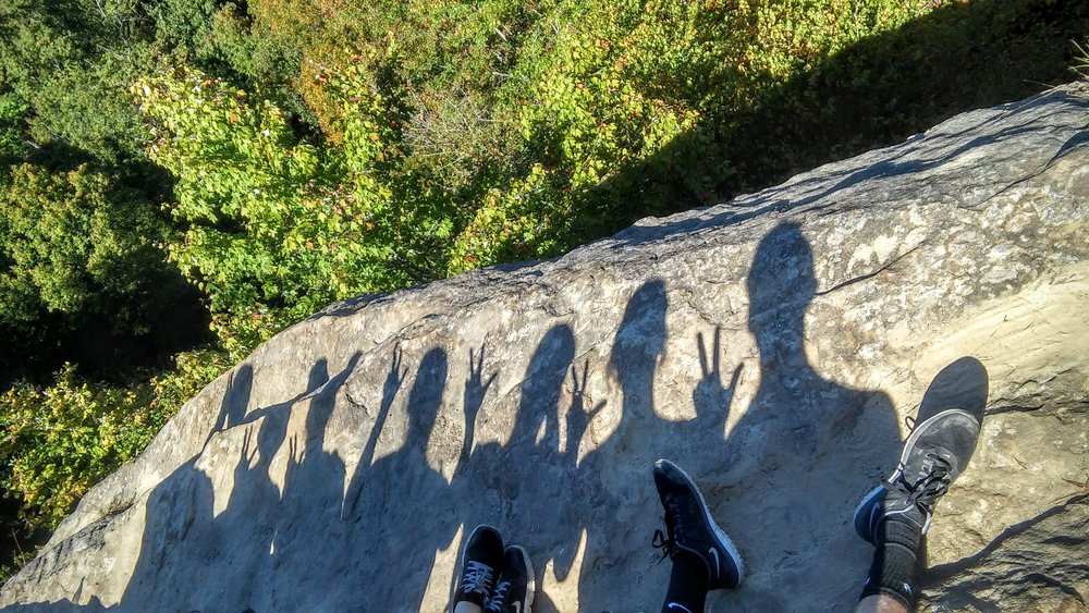 Shadows of my son and his friends atop Natural Bridge, KY.