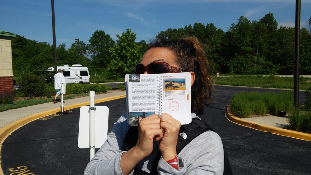 My excited wife after getting her National Parks Passport stamped at Indiana Dunes.