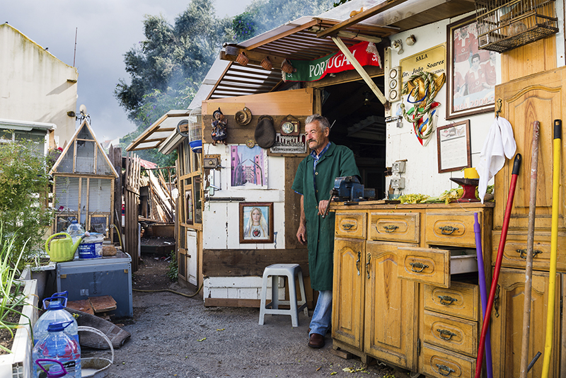 Mr. Quim portrayed in his informal, self-built, urban farm in the abandoned field behind Cabrinha, Lisbon, Portugal, 2017: vegetables, chickens and a various array of interesting memorabilia constituted a source of living and a place of gathering for him and for others that lives in the neighbourhood. Will Cabrinha's kids follow the path of Joaquim, or will they escape to the world forgetting Cabrinha?