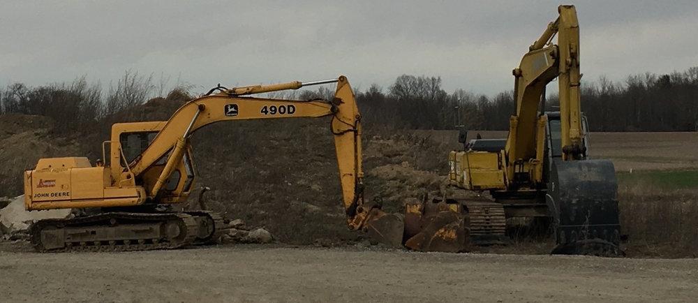 John Deere and Kobelco Excavators