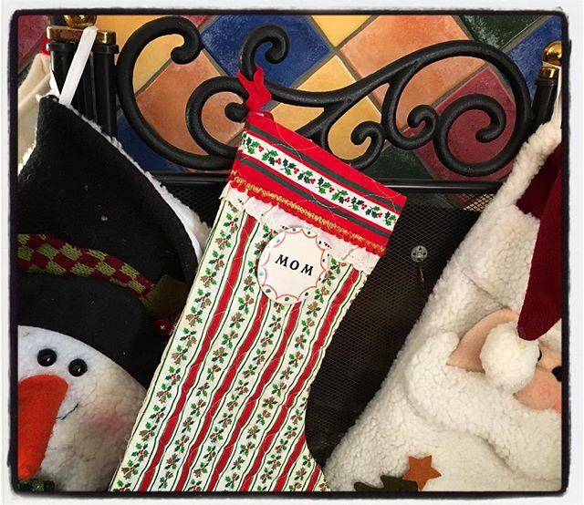 Wouldn't be Christmas without mom. Her simple stocking hangs with our children's more flamboyant ones. Over the years, she made 21 identical stockings as her family grew with in-laws and grandchildren. #tistheseason #family #moms #christmasstocking #sewing
