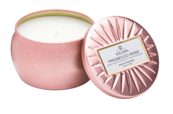 Travel Candle  - Ok, so this is a GAME changer.  Once I started traveling with candles I never looked back.  I'll stock up on these and just keep them in my luggage.  These Voluspa rose gold tins are only $9 and makes such a difference in the ambiance of the room!