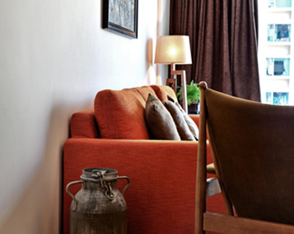 burnt orange couch and milk jug.jpg