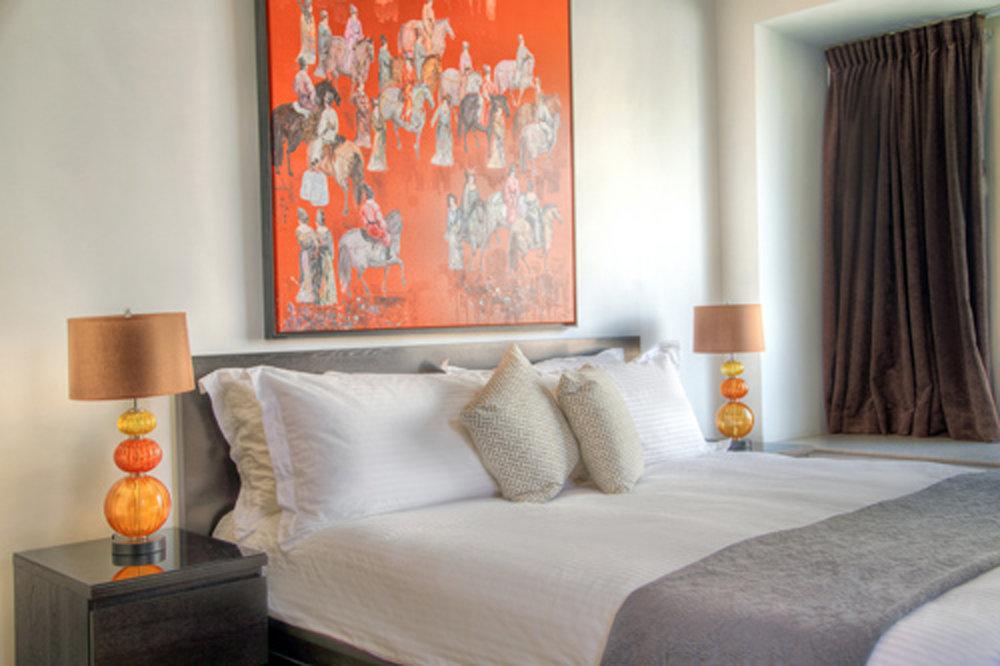 orange painting in master bedroom.jpg