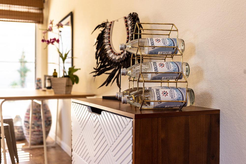 feather wedding necklace in kitchen nook.jpg