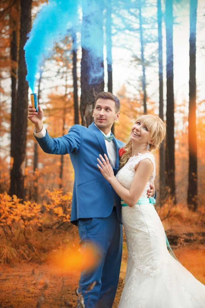 Norilsk Siberia - Married couple in love among trees with blue smoke