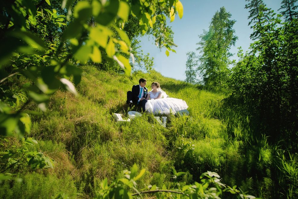 Norilsk people - Couple of lovers sitting on the grass without pollution