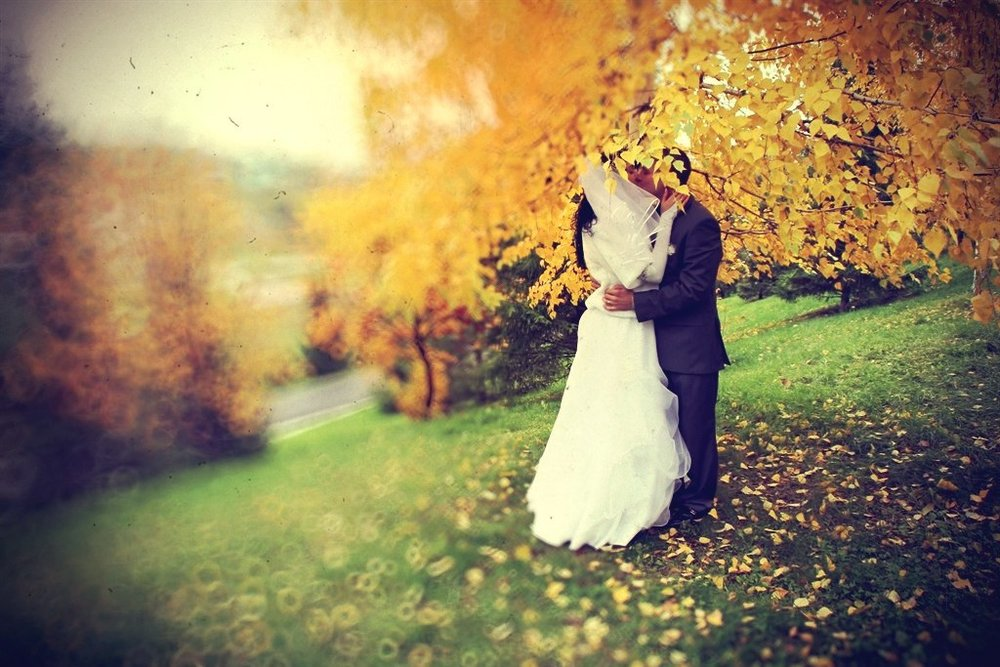 Norilsk Siberia - Russian couple kissing under the trees