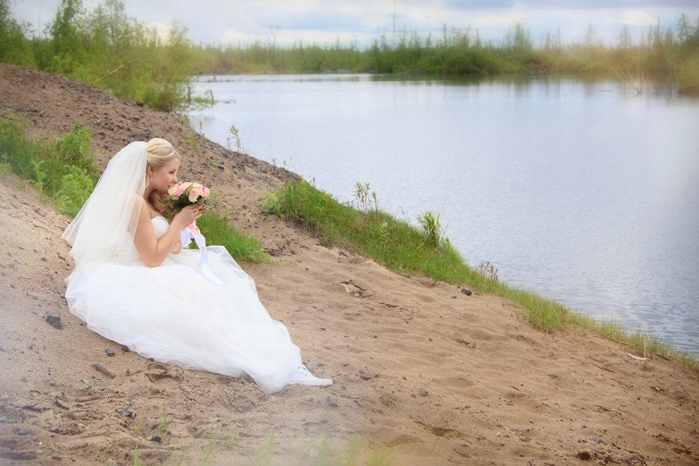 Norilsk Siberia -   Pretty Russian girl on the lake shore