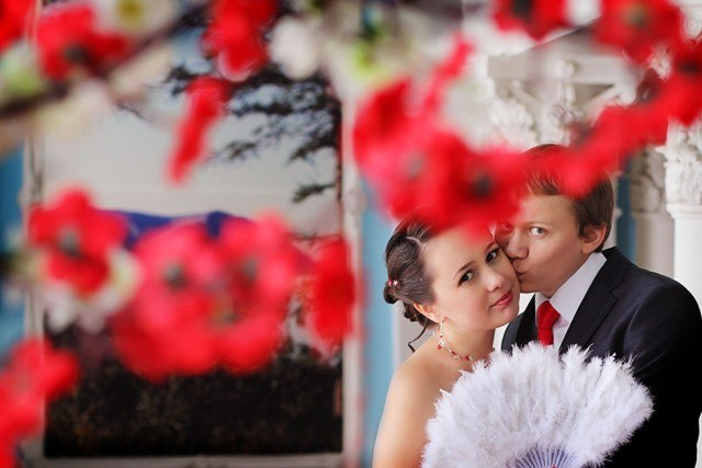 Norilsk life - Russian couple posing with flowers
