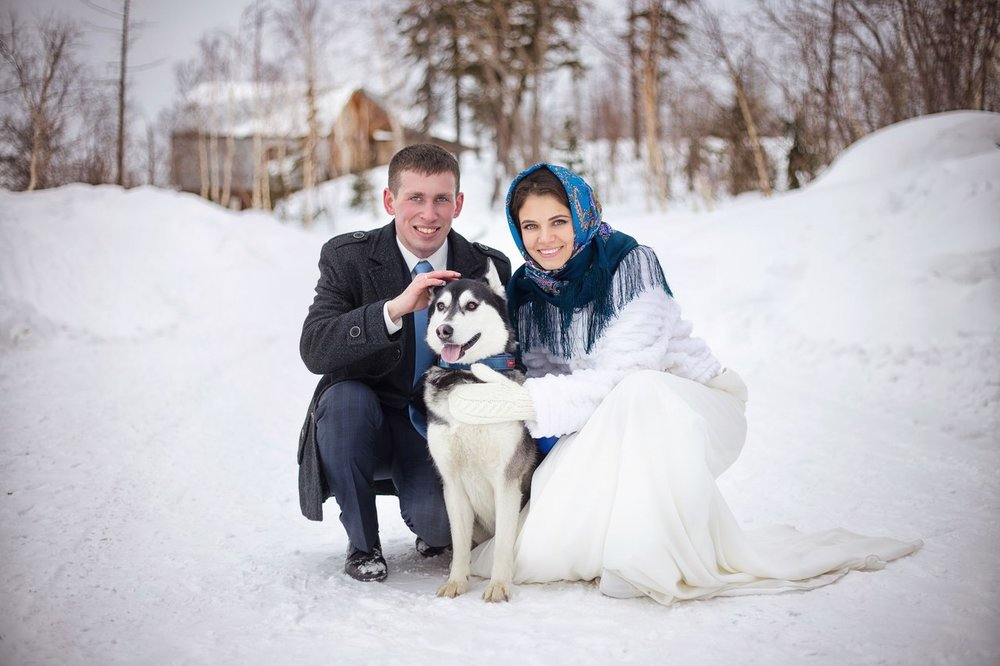 Couple from Norilsk with a Siberian Husky