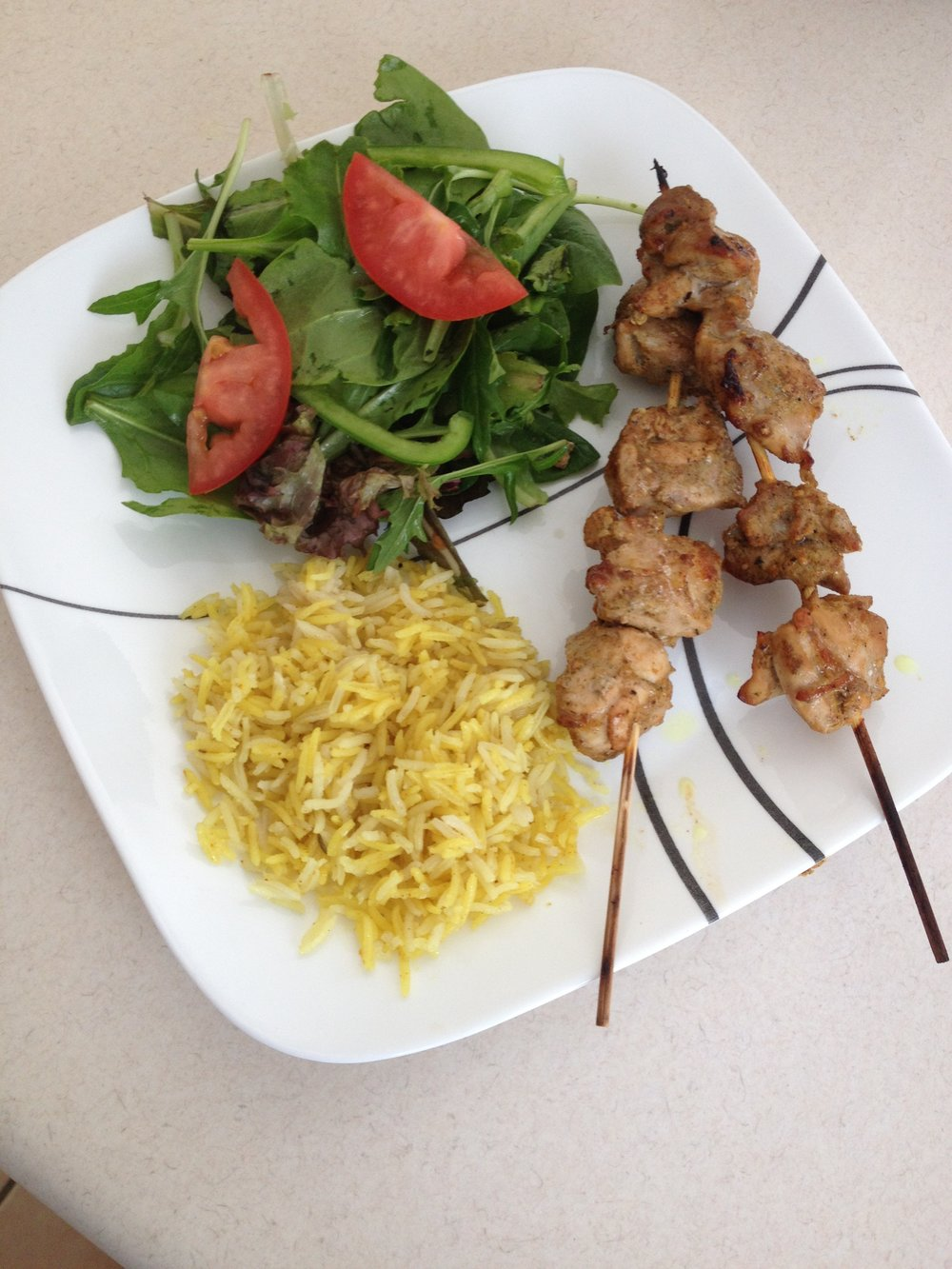 A Mediterranean Meal: Lebanese Chicken Kebabs with Saffron Rice and Garden Salad.
