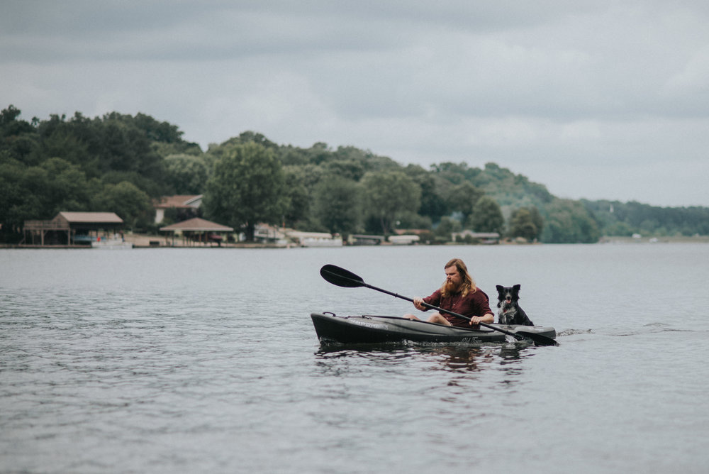 Mike Quain is The Nikon Kidd, a Northwest Arkansas Wedding photographer. Here you see him in a kayak with his dog, Ese.