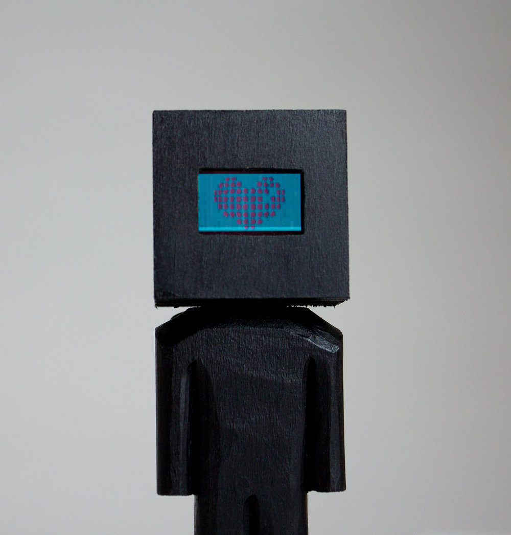 """Glitched Head"" Collaboration with AtlTvHead. Basswood, acrylic, and digital components. 5.25 x 1.5 x 1.5 inches. CSK 020G"