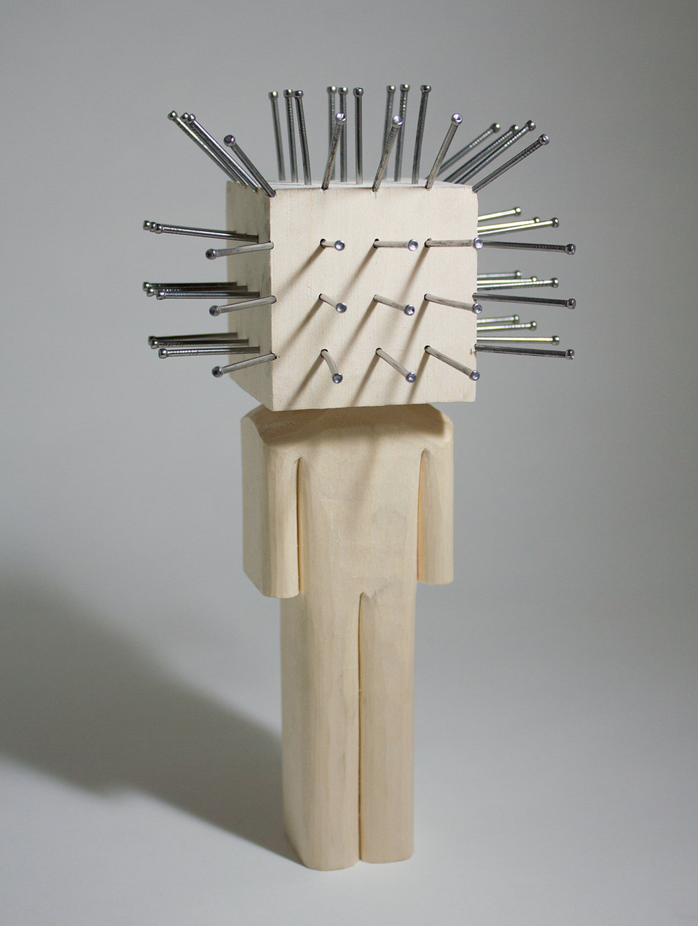 """Pinhead"" Basswood and nails. 8.5 x 4.5 x 3.25 inches. CSK 012G"