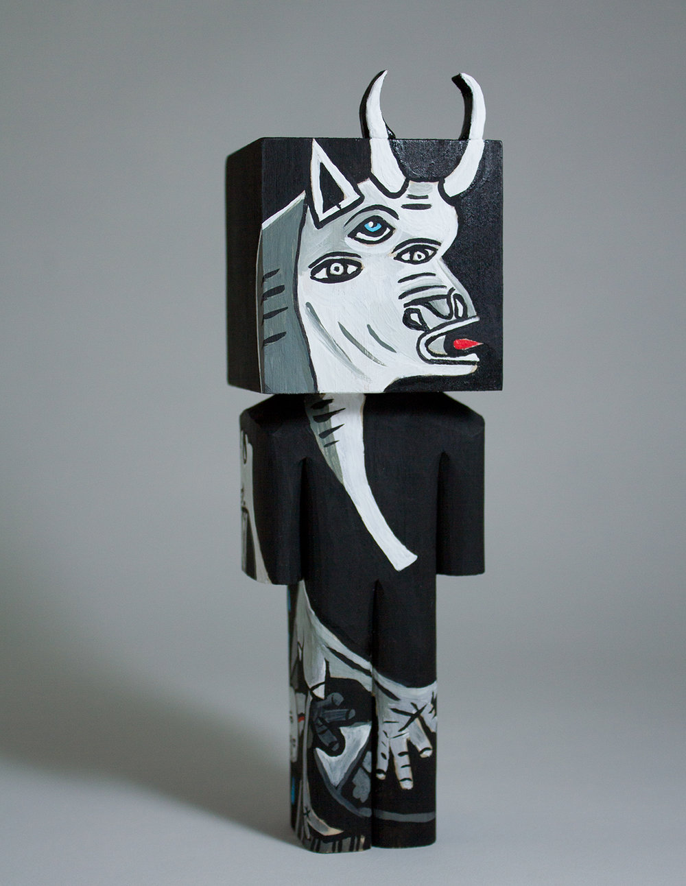 """Woke Bull"" Collaboration with Donna Howells. Basswood and acrylic. 7.5 x 2.25 x 2 inches. CSK 023G"