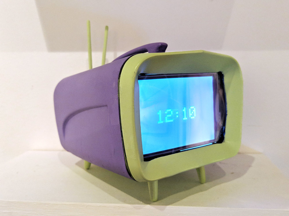 AtlTvHead   Model A AO4 (Green/Purple),    3D Printed PLA casing, LCD screen, ESP 32, 5.5 x 5.5 x 5 inches