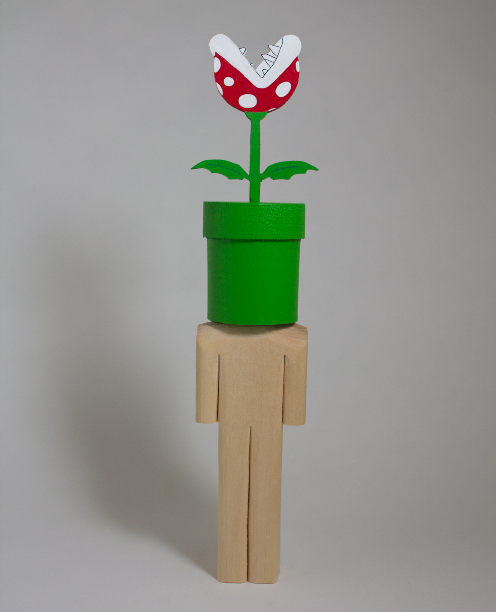 Piranha Plant    basswood and acrylic  2.4 x 2.2 x 12 inches  CSK 045G