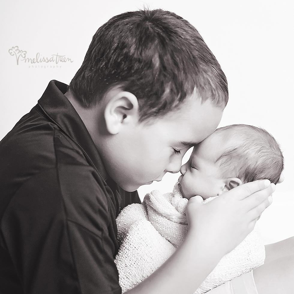 brother with newborn baby photo greensboro nc