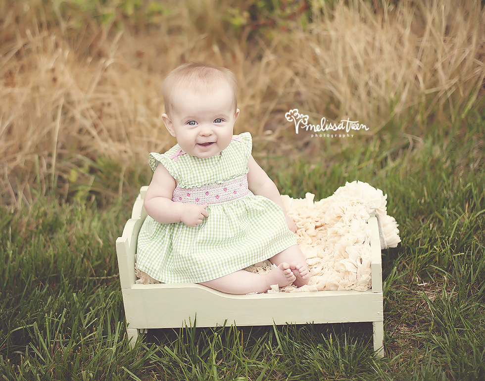 adorable 6 month old baby sitting in little baby bed in field of nature greensboro nc baby photography melissa treen photography burlington nc.jpg