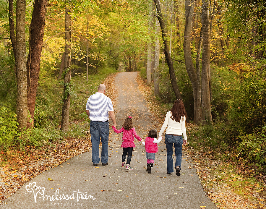 fall family photos on path with foilage leaaves turning orange red green yellow colors of fall in nature north carolina leaves changing color mleissa treen photography burlington nc.jpg