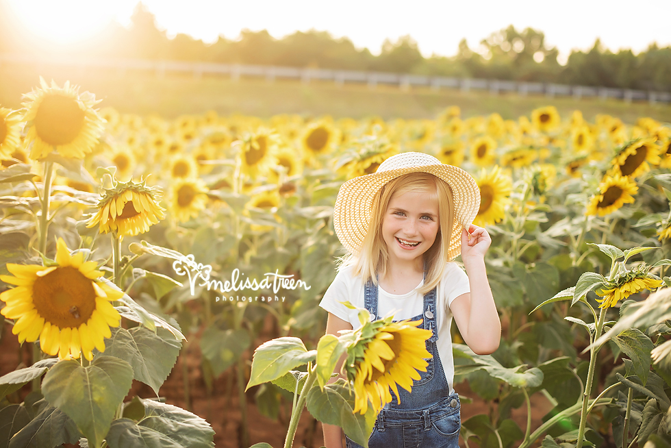 I have been photographing this beautiful little girl for many years now and she is always the sweetest!  We met for a fun photo shoot and we ended the portrait session at this gorgeous sunlit sunflower field between Chapel Hill and Winston Salem North Carolina.  She was full of smiles and we captured stunning images amidst the sunflowers.