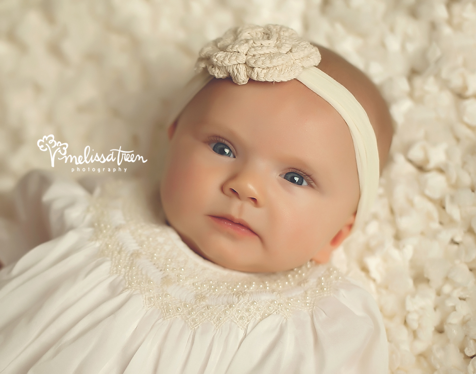 Good morning Miss Blue Eyes!  This baby girl visited the studio for her 4 month milestone photo shoot.  We are always giddy to see our little baby portrait planners return to the studio and to see how they have grown!  Wide awake and completely calm and alert is ho she arrived, she shared plenty of smiles with us, which we will share soon, but I love this little baby gaze.  The baby gaze is actually a look I always try to capture.  It's signature to the first months of baby's development and defines the beginning of their stage of curiosity where they are visualizing things with curiosity.  The end result is a sweet, precious capture I like to call the baby gaze.