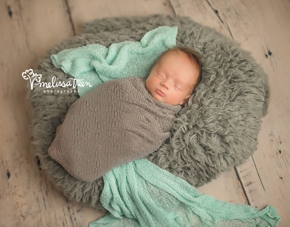 Baby boys ... they have been abundant in the studio lately and we love capturing them!  We paired grey and mint together in this custom styled newborn portrait session for a modern look to match baby's nursery.  Did you know ... each and every one of our portrait sessions are custom styled?  We put our background in design into use daily as we style sessions unique for each client.    Our Baby Portrait Plan begins with a maternity photo shoot and offers unlimited sessions throughout baby's first year to capture every milestone along the way!