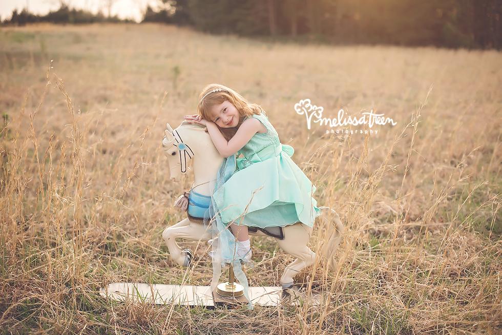 redhead-child-on-carousel-horse-in-field-sunset-greensboro-family-photographer-burlington-nc.jpg